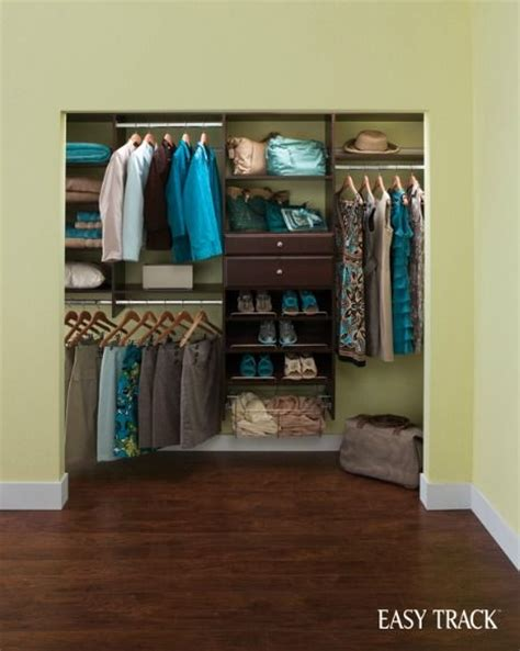 a reach in closet organizer that offers a devoted place