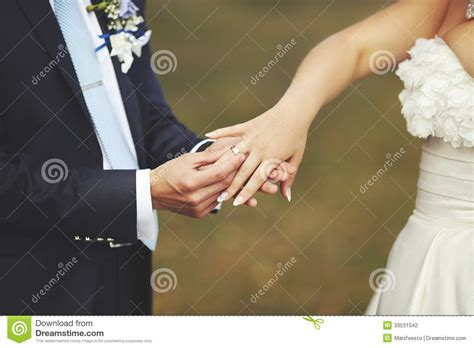 place this wedding ring upon your finger groom put a wedding ring finger of his lovely stock image 33531042
