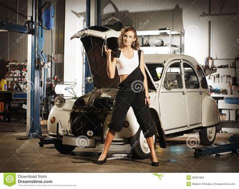 Frau In Garage by A Repairing A Car In A Garage Stock Photos Image