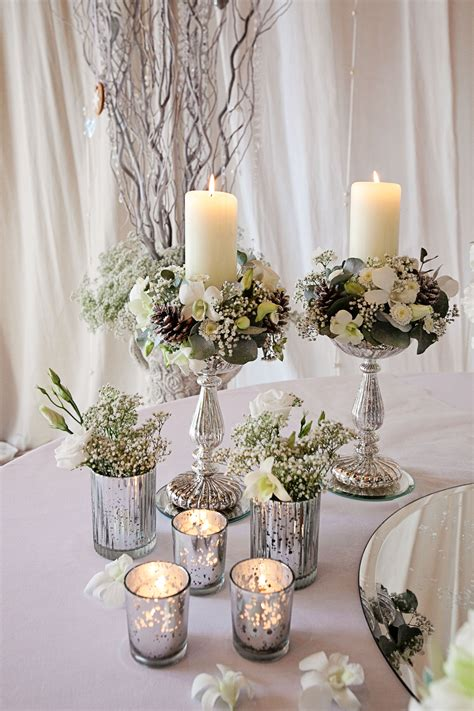 Silver Glasses With Candles Combined With Silver Vases