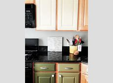 Straight Shaped Two Toned Cabinets In Kitchen With Grey