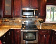oak cabinets in kitchen airstone backsplash in kitchen quot autumn mountain quot maple 3562