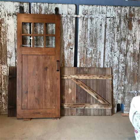 reclaimed oak barn door  glass furniture   barn