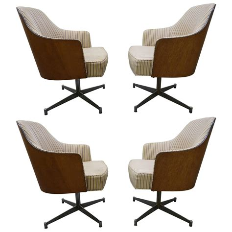 four milo baughman style teak back swivel dining chairs