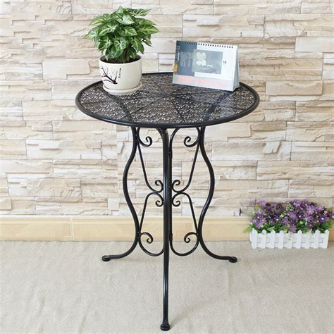 small metal table l small side table with petrified wood top and metal legs at