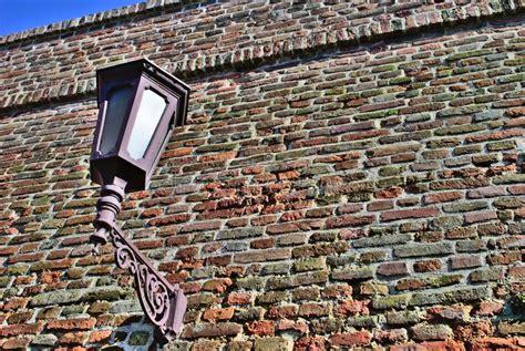 brick wall with street light image of street