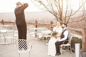 wedding photographer taking bride and groom portraits With taking wedding pictures
