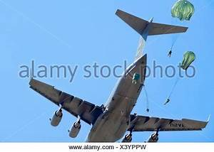 Paratroopers from the 82nd Airborne Division receive an ...