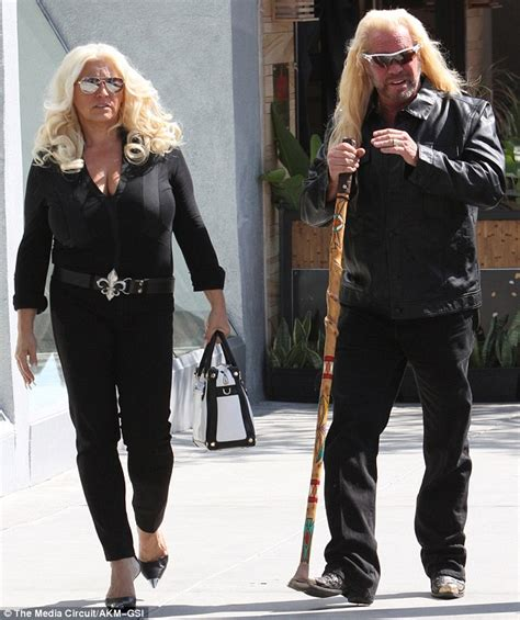 duane 39 dog 39 chapman 63 leans on walking stick as famed