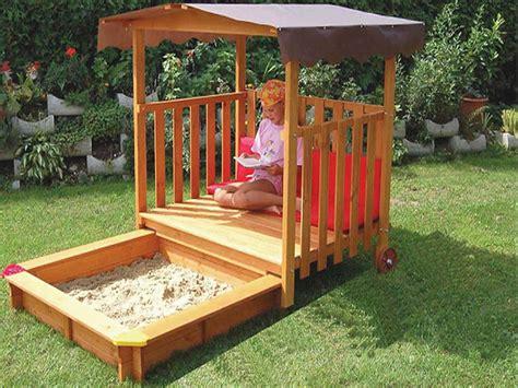 exaco rolling playhouse covered sandbox playhouse