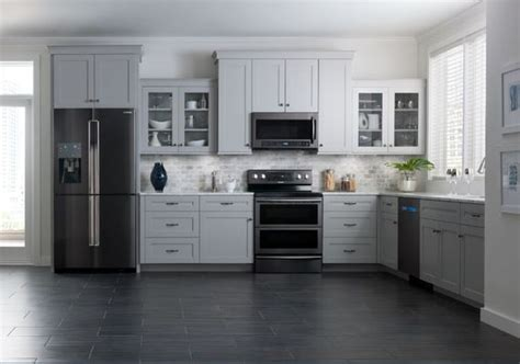 black kitchen cabinets with stainless steel appliances samsung brings black stainless steel finish to kitchen 9767