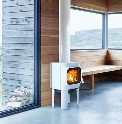The legs are angled from all sides and sculpted to a. window | Contemporary wood burning stoves, Wood burning stove, Woodburning stove fireplace