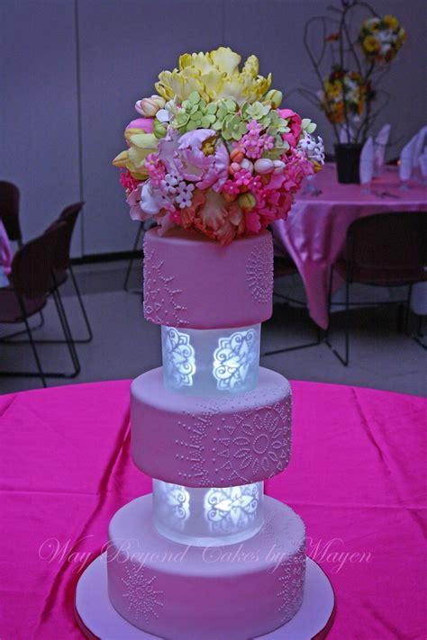 pale pink cake   illuminated tiers separators