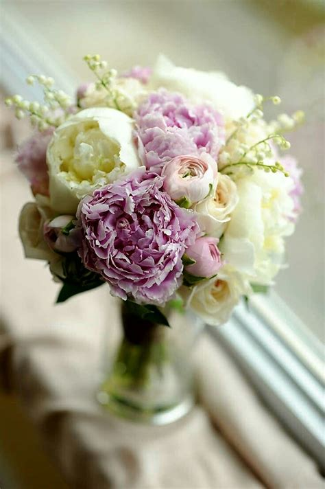 wedding bouquet featuring pink peonies pink ranunculus