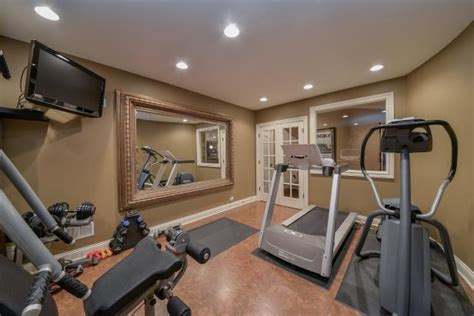 Home Gym With Large, Traditional, Thick Frame Mirror ...