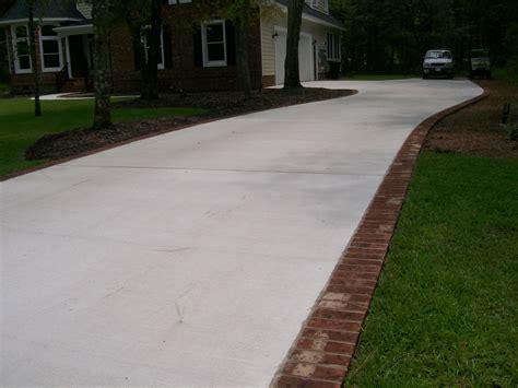 broom finish paver border driveway and sidewalks