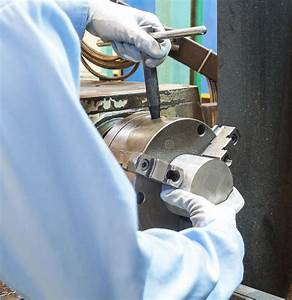 Operator Setup Turning Part On Manual Lathe Machine Stock