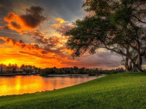 beautiful sunset red clouds villa lake coast green meadow