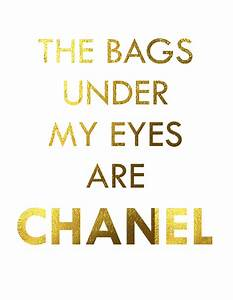 Bags under eyes are Chanel, faux gold foil print, bathroom