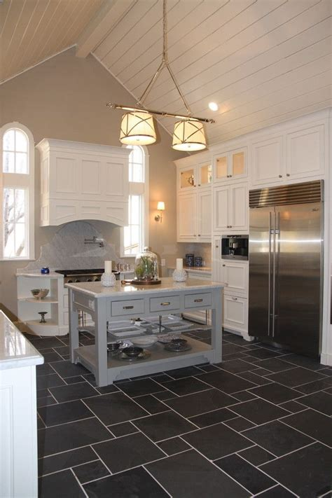 charcoal tile floor  white cabinets   grey