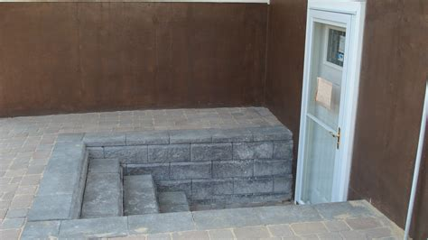 basement walkout securing your walkout basement entry stone and patio professionals pavers cultured stone