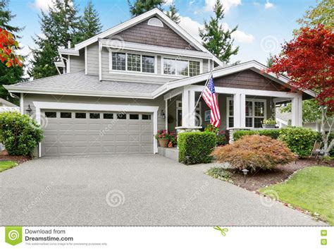 Nice Curb Appeal Of Grey House With Covered Porch And