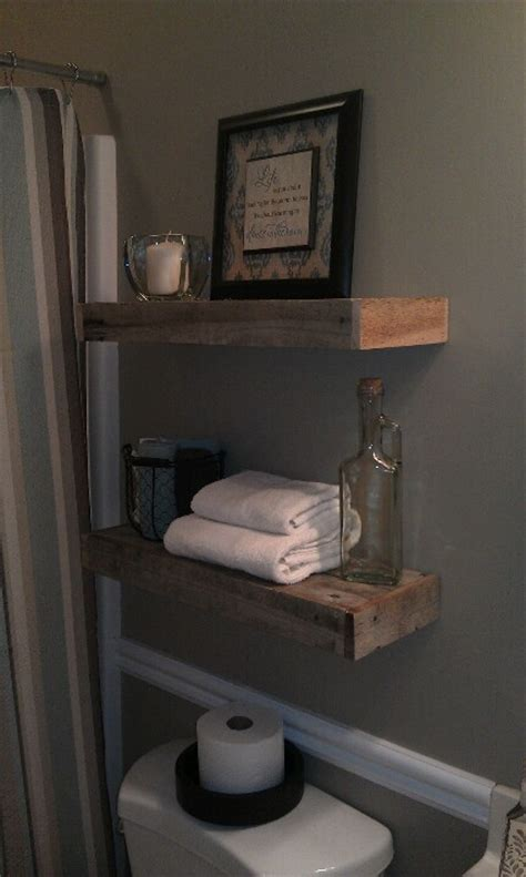 pallet wood floating shelves one the toilet in