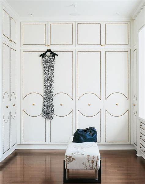 walk  closet  upholstered wardrobe doors  brass