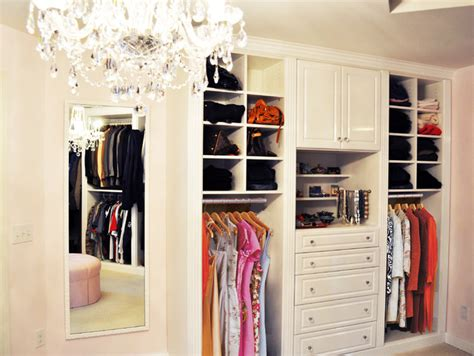 master closet in white high gloss traditional closet