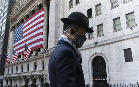 Dow, S&P 500 set records as investors react to positive ...