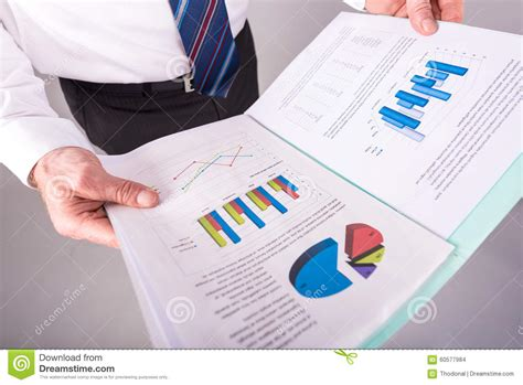 how to read stock businessman reading a report stock photo image 60577984