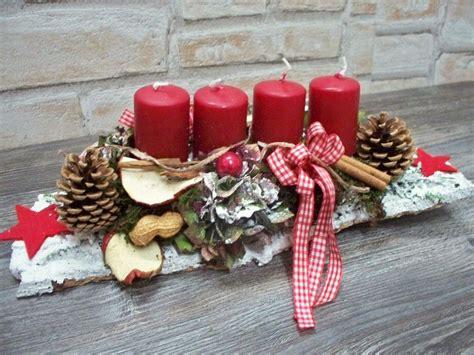 Weihnachtsgestecke Aus Holz by Adventsgesteck Auf Wei 223 Er Rinde Rot Wei 223 Landhaus