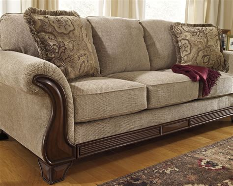 sofa  flared arms faux wood accents  signature