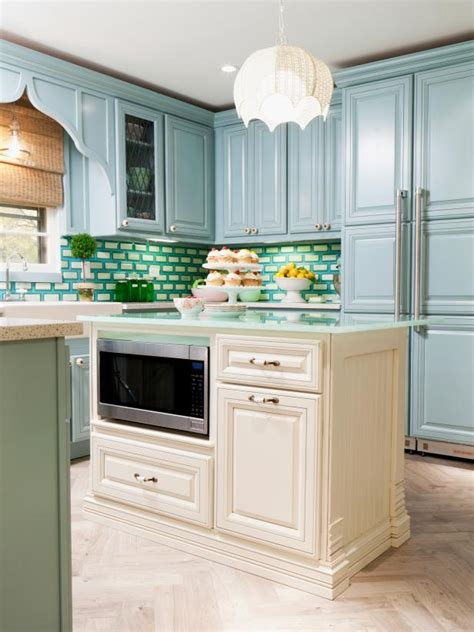 white kitchen island transitional kitchen with blue cabinets and white island 1366