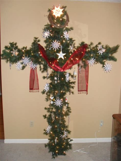 a cross christmas tree made from pcv pipe and garland