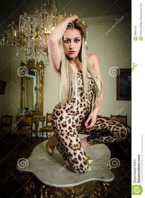 pretty blonde woman   leopard print dress stock photo