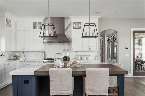 blue kitchen island  walnut countertop transitional