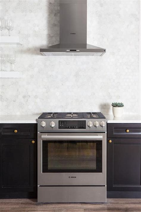 Black Kitchen Cabinets with White Marble Hexagon