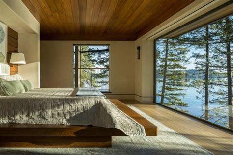 lakefront cliff house design  rocks integrated  interior design  spectacular windows