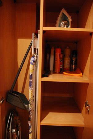 utility closet near front door with cleaning supplies and