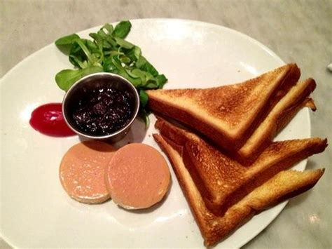 pat 233 of foie gras with toasted brioche picture of black