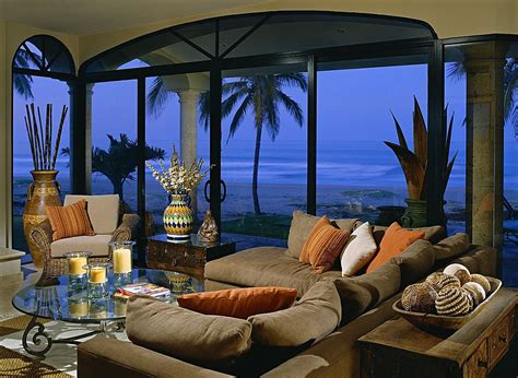 tropical themed living room  filled  grey pillow