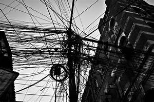 File An Electric Pole  Behind Office Buildings  At Kolkata