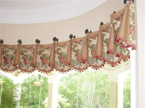 cuffed valance on medallions with tassel fringe secured