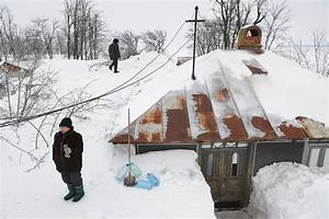 Heavy snowfall in Romania cuts off thousands for days ...