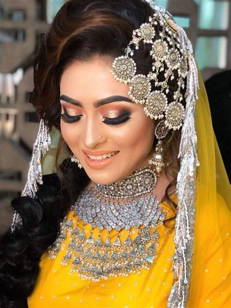 pin  peya  holud program ideas pakistani bridal makeup bride bridal mehndi dresses