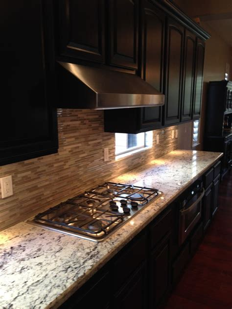 Redesigned kitchen including new granite, mosaic glass