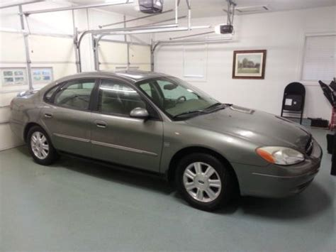 purchase   ford taurus sel sedan silver leather