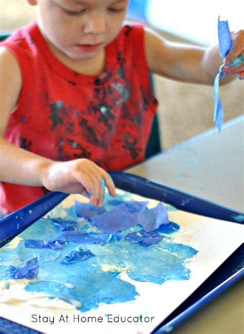 for toddlers and preschoolers process 163 | Sand tissue paper blue paint and star cut outs to make ocean theme process art in preschool great for toddlers too