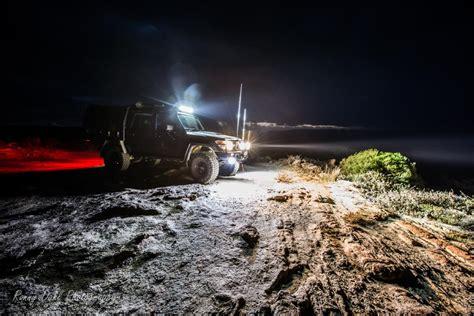 jeep light bar at night driving at night off road